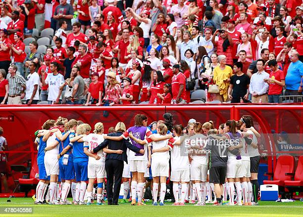 Members of the Switzerland soccer team hug after their loss at the FIFA Women's World Cup Canada 2015 Round 16 match between Switzerland and Canada...