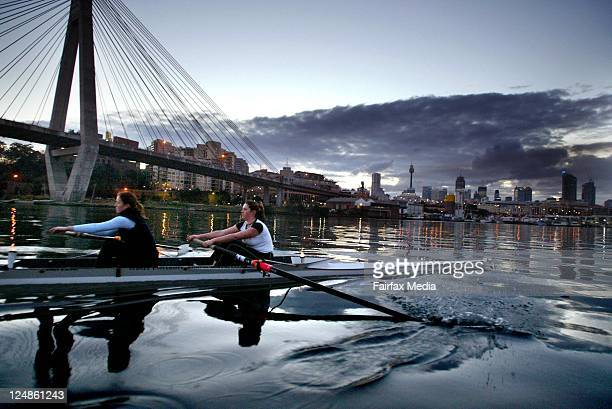 Members of the Sydney University Womens rowing team training early in the morning as they row past a proposed marina and public boat ramp just near...