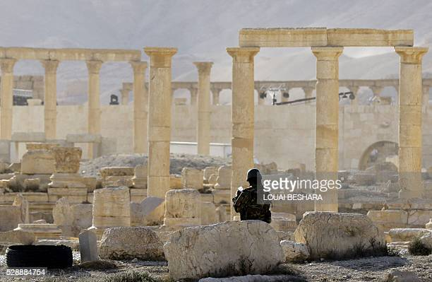 Members of the Syrian army patrol the ancient Syrian city of Palmyra on May 6 during a patriotic celebration put on by the Syrian regime at the...