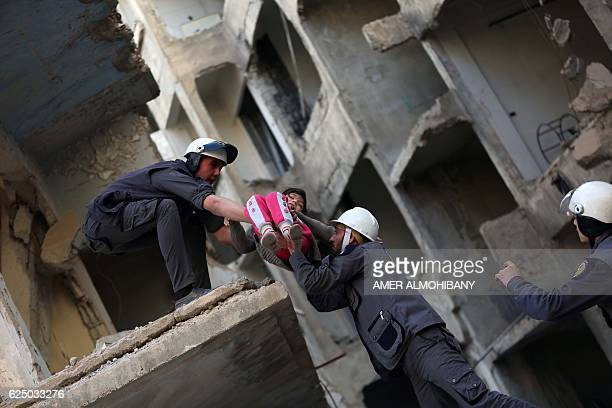 Members of the Syrian Civil Defence known as the White Helmets evacuate a child during a training session in the rebelheld eastern Ghouta area east...