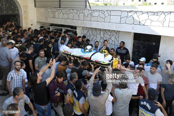 Members of the Syrian Civil Defence known as White Helmets and friends carry the body of citizen journalist Anas alDyab during his funeral in the...