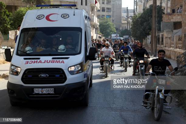 Members of the Syrian Civil Defence known as White Helmets and friends march during the funeral of citizen journalist Anas alDyab in the rebelheld...