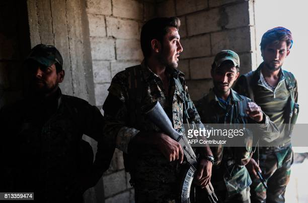 Members of the Syrian Democratic Forces an alliance of Kurdish and Arab fighters hold a position in western Raqa on July 12 during an offensive to...