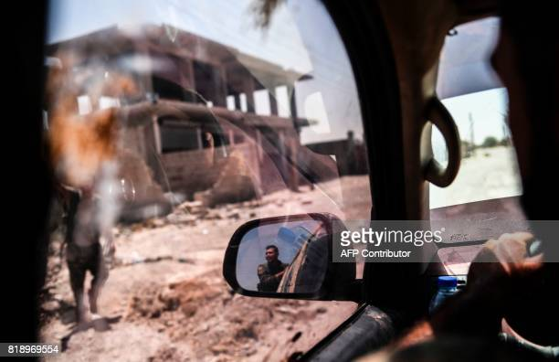 TOPSHOT Members of the Syrian Democratic Forces an alliance of Kurdish and Arab fighters drive on the western front in Raqa on July 19 during an...