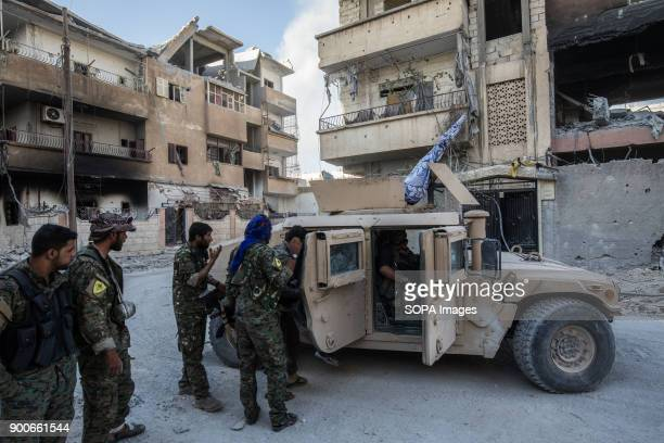 Members of the Syrian Democratic Forces are driving toward the frontline during a battle against Islamic State group jihadists to retake the central...