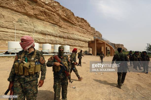 Members of the Syrian Democratic Forces are pictured in the village of Susah in the eastern province of Deir Ezzor near the Syrian border with Iraq...