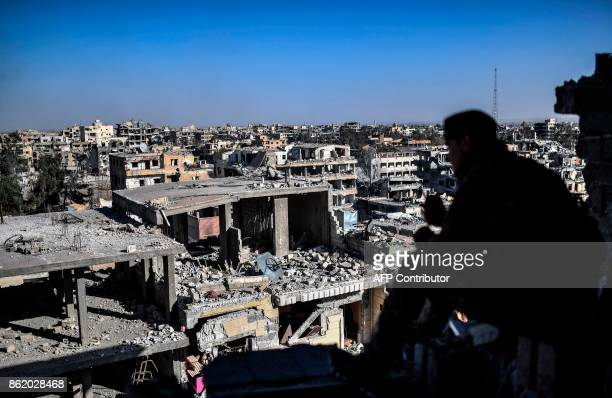 Members of the Syrian Democratic Forces backed by US special forces monitor the a near Raqa's stadium as they clear the last positions on the...