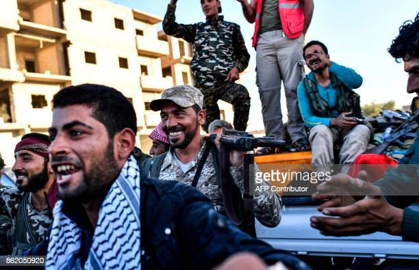 Members of the Syrian Democratic Forces backed by US special forces celebrate at the frontline in the Islamic State group jihadists crumbling...