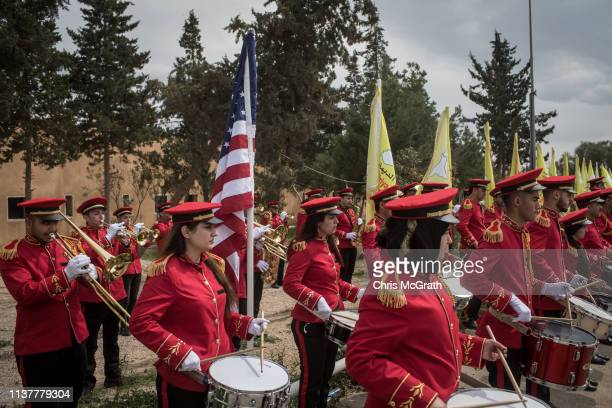 Members of the Syrian Democratic Forces band play the American anthem during a SDF victory ceremony announcing the defeat of ISIL in Baghouz held at...