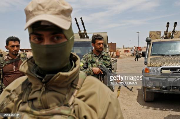 TOPSHOT Members of the Syrian Democratic Forces gather at the alTanak oil field as they prepare to relaunch a military campaign against the Islamic...