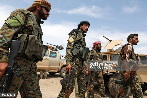 Members of the Syrian Democratic Forces gather at the alTanak oil field as they prepare to relaunch a military campaign against the Islamic State...