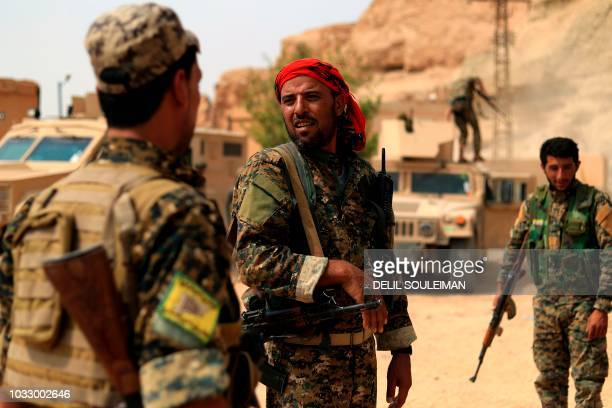 Members of the Syrian Democratic Forces gather in the village of Susah in the eastern province of Deir Ezzor near the Syrian border with Iraq on...