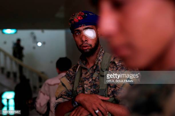 Members of the Syrian Democratic Forces gather inside a building in the village of Susah in the eastern province of Deir Ezzor, near the Syrian...