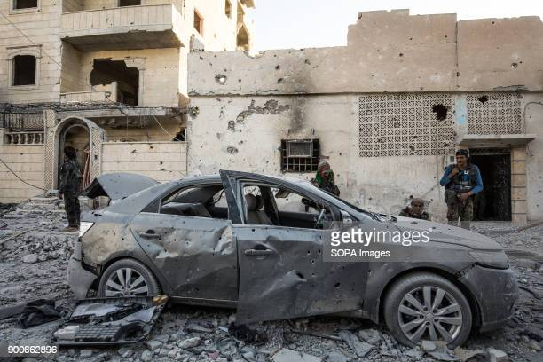 Members of the Syrian Democratic Forces seen guarding the new liberated neighbourhood in Raqqa The Syrian civil war has been carried on for more than...