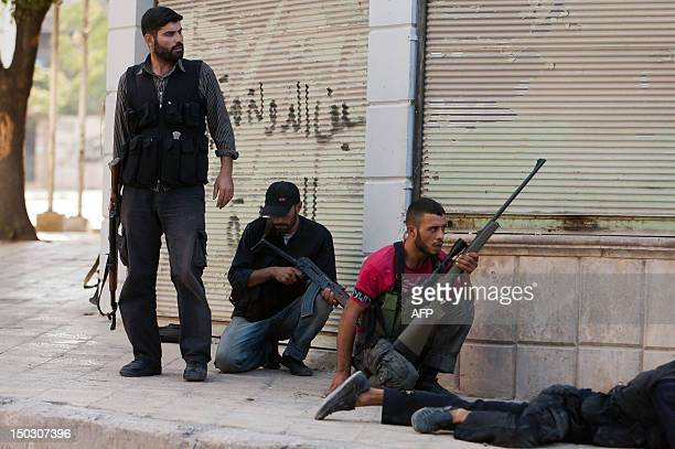 Members of the Syrian opposition take position during fighting against forces loyal to President Bashar alAssad in the disputed neighbourhood of...