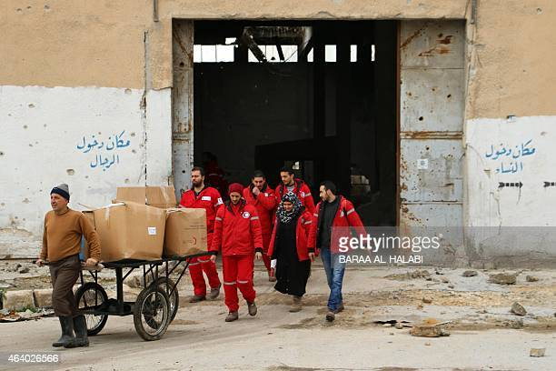 Members of the Syrian Red Crescent cross through the Garage alHajz crossing on February 21 from a regime held area to a rebelcontrolled area in...