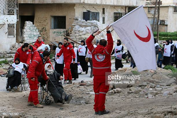 Members of the Syrian Red Crescent transport Syrians from a rebelcontrolled area to a regime held area of the northern Syrian city of Aleppo on...