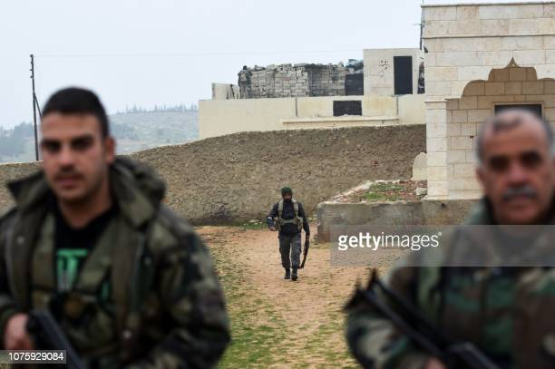 Members of the Syrian regime forces gather in the southern countryside of the northern Kurdishcontrolled city of Manbij on December 30 2018 The...