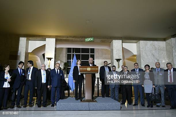 Members of the Syria's main opposition group Deputy Head George Sabra speaks next to Bassma Kodmani and the members of the High Negotiations...