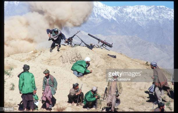 Members of the Taliban army fight on the front line October 21, 1996 near Kabul, Afghanistan. The Taliban army faces opposition by the guerrillas of...
