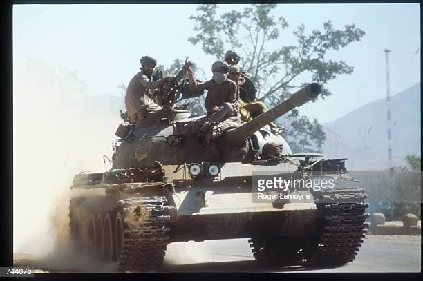 Members of the Taliban army ride atop a tank October 15 1996 near Kabul Afghanistan The Taliban army faces opposition by the guerrillas of Ahmas Shah...