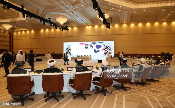 Members of the Taliban attend the Intra Afghan Dialogue talks in the Qatari capital Doha on July 7 2019 Dozens of powerful Afghans met with a Taliban...