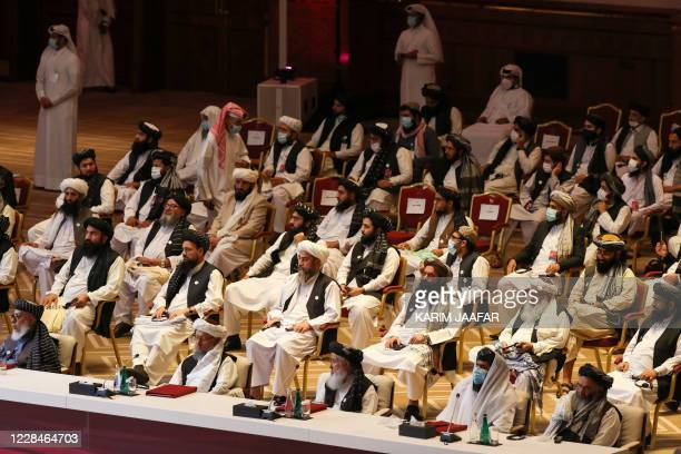Members of the Taliban delegation attend the opening session of the peace talks between the Afghan government and the Taliban in the Qatari capital...