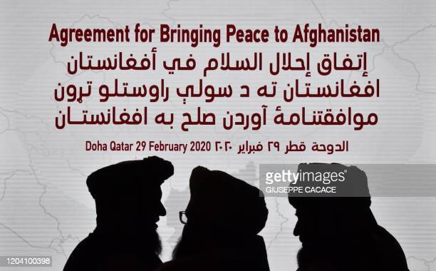 TOPSHOT Members of the Taliban delegation gather ahead of the signing ceremony with the United States in the Qatari capital Doha on February 29 2020...
