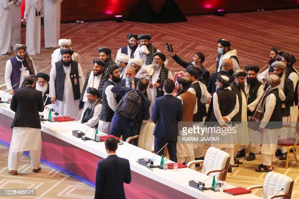Members of the Taliban delegation leave their seats at the end of the session during the peace talks between the Afghan government and the Taliban in...