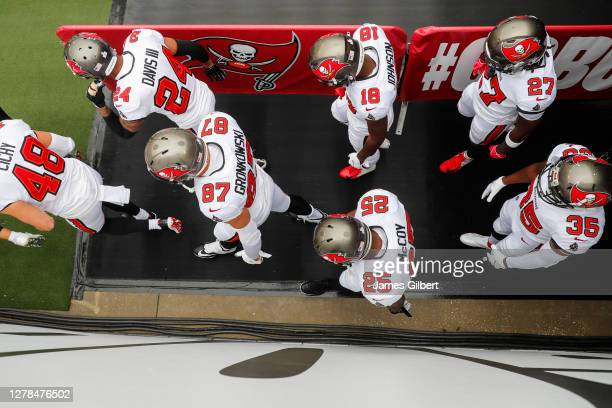 Members of the Tampa Bay Buccaneers including Rob Gronkowski, LeSean McCoy, Jamel Dean, Ronald Jones, Carlton Davis and Tyler Johnson enter the field...