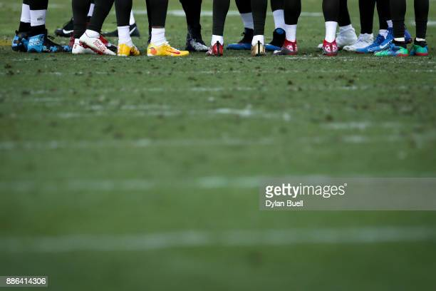 Members of the Tampa Bay Buccaneers wear custom cleats during the game against the Green Bay Packers at Lambeau Field on December 3 2017 in Green Bay...