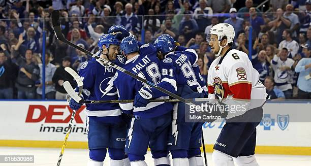 Members of the Tampa Bay Lightning celebrate a goal by Ondrej Palat as Alex Petrovic of the Florida Panthers reacts during the second period at the...