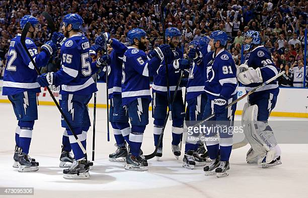 Members of the Tampa Bay Lightning celebrate a win over the Montreal Canadiens in Game Six of the Eastern Conference Semifinals during the 2015 NHL...