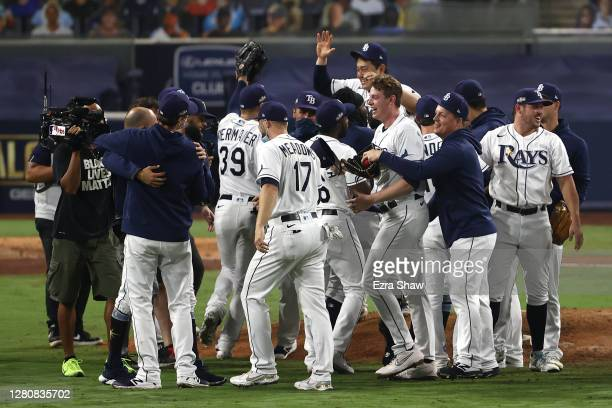 Members of the Tampa Bay Rays celebrate a 4-2 win against the Houston Astros to win the series in Game Seven of the American League Championship...