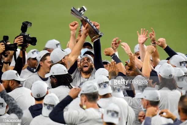 Members of the Tampa Bay Rays hold the William Harridge Trophy after defeating the Houston Astros in Game Seven of the American League Championship...