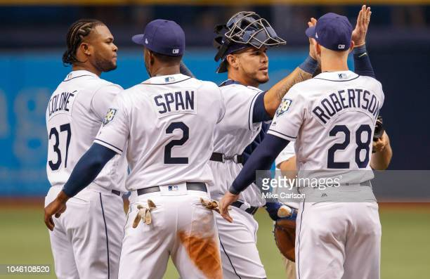 Members of the Tampa Bay Rays including Alex ColomeDenard Span Wilson Ramos and Daniel Robertson celebrate a win in the game between the Boston Red...