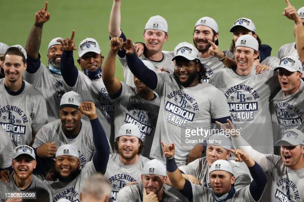 Members of the Tampa Bay Rays pose with the William Harridge Trophy after defeating the Houston Astros in Game Seven of the American League...