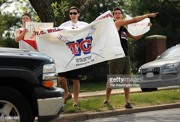 Members of the TC Williams crew team from left junior Chris Porter senior Constantine Ivanis and sophomore Greg Montenegro solicit business on West...