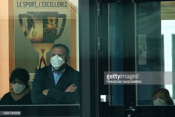 Members of the teaching and administrative staff at the Jean de la Fontaine school in Crepy-en-Valois , northern France, wear masks while tests are...