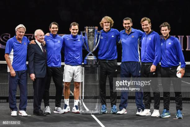 Members of the Team Europe along with Former tennis player Rod Laver pose with the trophy as they celebrate winning the Laver Cup tennis tournament...
