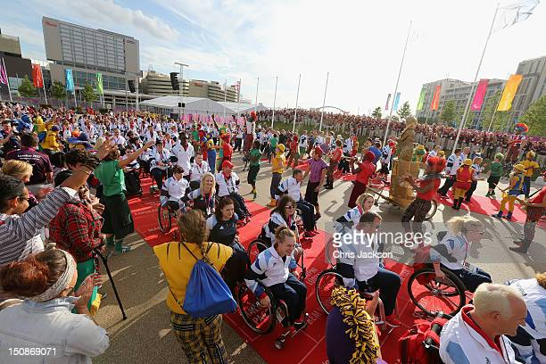 Members of the Team GB Paralympic are welcomed by dancers during a welcome ceremony at the Paralympic Village on August 28 2012 in London England