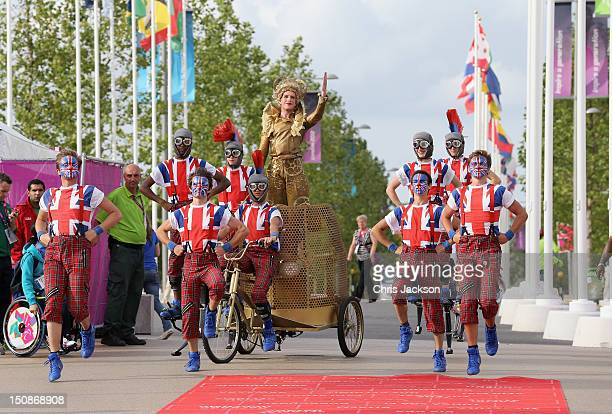 Members of the Team GB Paralympic Team are cheered in by dancers during a welcome ceremony at the Paralympic Village on August 28 2012 in London...