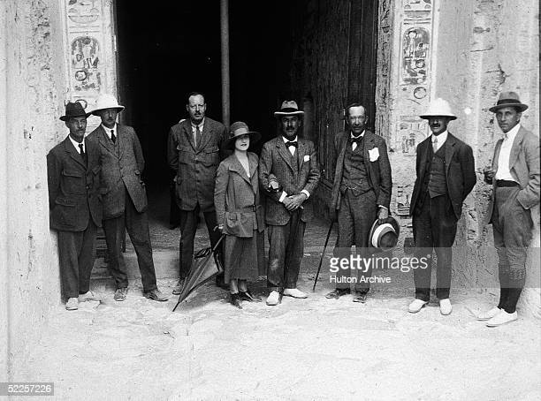 Members of the team that discovered the tomb of the Pharaoh Tutankhamen pose before the entrance to a tomb possibly that of of Ramses IV or Ramses V...
