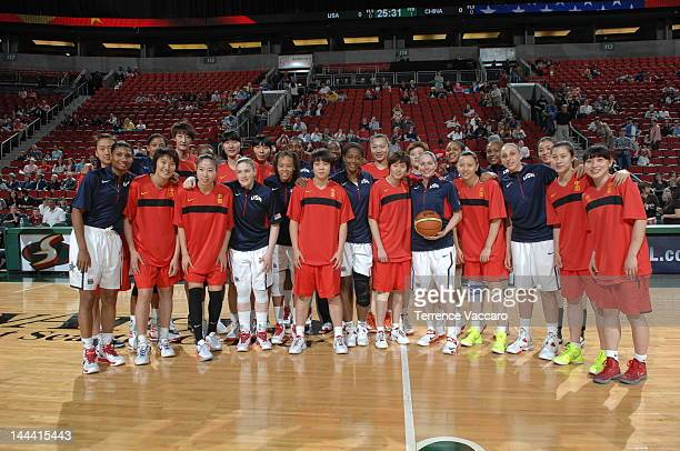 Members of the Team USA pose with members of team China during the international exhibition game between the 2012 USA Basketball Women's National...
