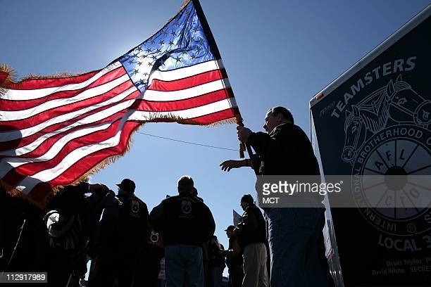 Members of the Teamsters Union protest management contracts for US ports at the Seagirt Marine Terminal at the Port of Baltimore Maryland on Friday...