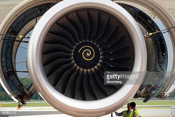 Members of the technical crew inspect the engine of a Singapore Airlines Ltd Airbus A380 airplane at Changi Airport in Singapore on Friday Oct 30...