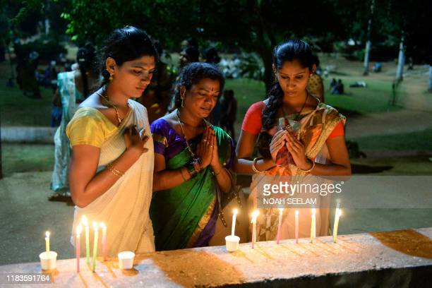 Members of the Telangana Transgender community hold a candlelight vigil to mark the 'Transgender Day of Remembrance', in Hyderabad on November 20,...