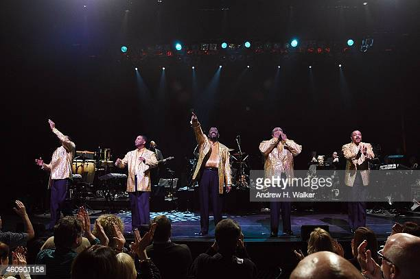 Members of The Temptations Joe Herndon Terry Weeks Otis Williams Bruce Williamson and Ronald Tyson take their curtain call bow at The Temptations and...