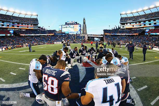 Members of the Tennessee Titans and the New England Patriots pray together after their game at Gillette Stadium on December 20 2015 in Foxboro...