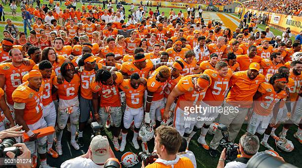 Members of the Tennessee Volunteers gather to sing with the band to celebrate a victory over Northwestern Wildcats in the Outback Bowl at Raymond...